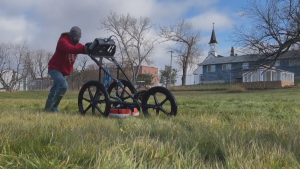 A ground-penetrating radar crew searches the site of a former residential school in northern Alberta (Source: Institute of Prairie and Indigenous Archaeology).