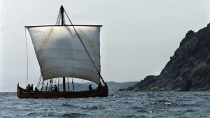 The replica Viking boat Snorri, built in Maine, heads past an island near L'Anse aux Meadows, N.L., in July 2000. The vessel was part of a flotilla that will travelled to the historic site with the Islendingur, a Viking longship, honouring Lief Ericson's voyages around the year 1000 AD.(CP PHOTO/Andrew Vaughan)