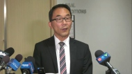 Sean Chu speaks to reporters on Thursday, Oct. 21, 2021 at Calgary city hall.