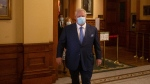 Ontario Premier Doug Ford makes his way to a press briefing at the Queens Park Legislature in Toronto, on Friday, October 15, 2021. THE CANADIAN PRESS/Chris Young