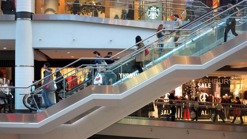 Shoppers mill through Toronto's Eaton Centre shopping centre on the last day before Christmas, Thursday, Dec. 24, 2015. THE CANADIAN PRESS/Peter Cameron
