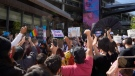 """People protest outside the Netflix building on Vine Street in the Hollywood section of Los Angeles, Wednesday, Oct. 20, 2021. Critics and supporters of Dave Chappelle's Netflix special and its anti-transgender comments gathered outside the company's offices Wednesday, with """"Trans Lives Matter"""" and """"Free Speech is a Right"""" among their competing messages. (AP Photo/Damian Dovarganes)"""