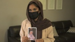 Ammarah Navab holds a photo of her late sister, Farisa. (CTV Kitchener)