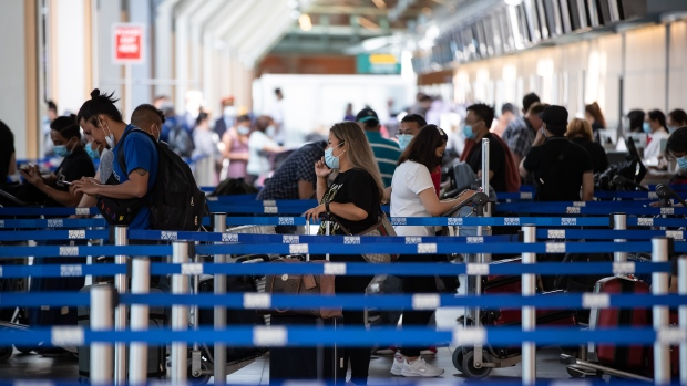 Travellers wait in line to check-in for a Philippine Airlines flight to Manila at Vancouver International Airport, in Richmond, B.C., on Friday, July 30, 2021.  THE CANADIAN PRESS/Darryl Dyck