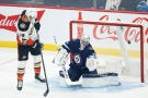 Anaheim Ducks' Troy Terry (19) tips the puck past Winnipeg Jets goaltender Connor Hellebuyck (37) for the goal during first period NHL action in Winnipeg on Thursday, October 21, 2021. THE CANADIAN PRESS/John Woods