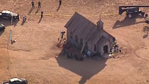 This aerial video image provided by KOAT 7 News, shows Santa Fe County Sheriff's Officers responding to the scene of a fatal accidental shooting at a Bonanza Creek, Ranch movie set near Santa Fe, N.M. Thursday, Oct. 21, 2021. (KOAT 7 News via AP)