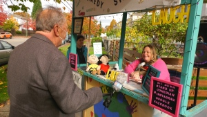 No matter the weather, one woman sets up a booth in Vancouver to spread light and laughter.