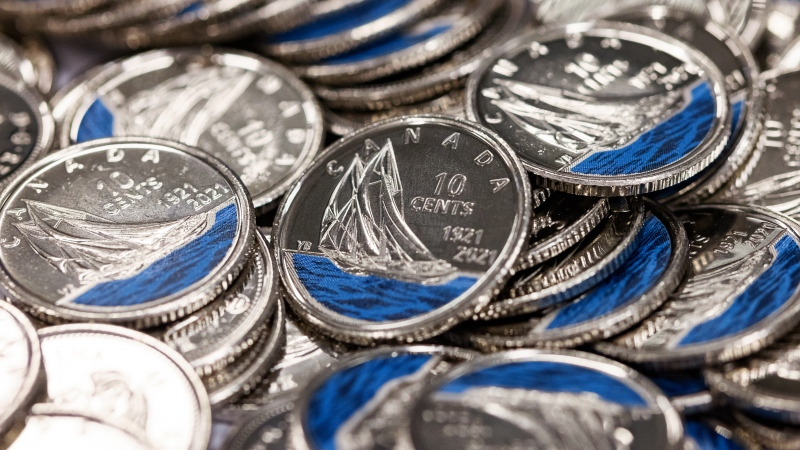 The Royal Canadian Mint is launching Canada's first-ever coloured dimes to commemorate the 100th anniversary of the Bluenose. (Royal Canadian Mint)