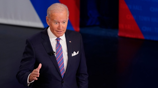 FILE - U.S. President Joe Biden participates in a CNN town hall at the Baltimore Center Stage Pearlstone Theater, Thursday, Oct. 21, 2021, in Baltimore, with moderator Anderson Cooper. (AP Photo/Evan Vucci)