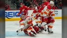 Calgary Flames goaltender Jacob Markstrom (25) deflects a Detroit Red Wings shot in the second period of an NHL hockey game on Oct. 21 in Detroit. (AP Photo/Paul Sancya)