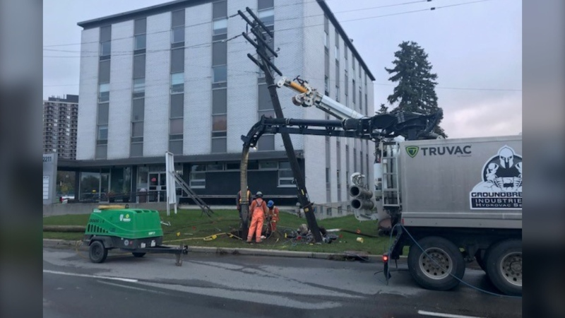 Crews work to repair a hydro pole at Riverside Drive and Bank Street after a car struck it overnight on Friday. (Jim O'Grady/CTV News Ottawa)