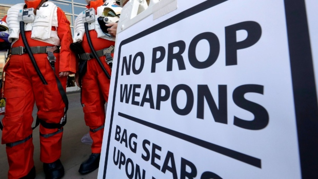 A sign forbidding prop weapons at Comicon at the Phoenix Convention Center, on May 26, 2017. (Matt York / AP)