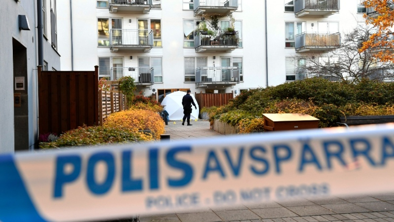 Forensic police at the site where Swedish rapper Einar was shot to death, in Hammarby Sjostad district in Stockholm, on Oct. 22, 2021. (Henrik Montgomery/TT via AP)