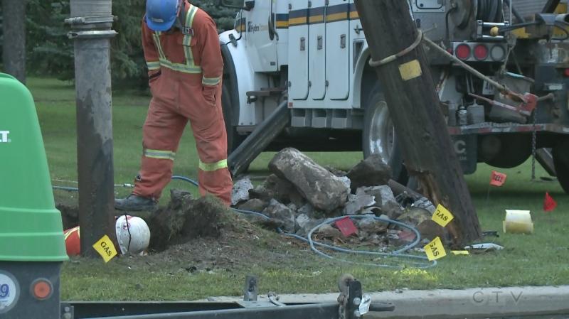 Crews work to repair damaged hydro pole