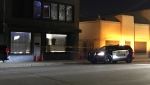 An EPS cruiser sits outside a building on 111 Avenue and 94 Street after reports of gunfire on Oct. 21. (Sean McClune/CTV News Edmonton)