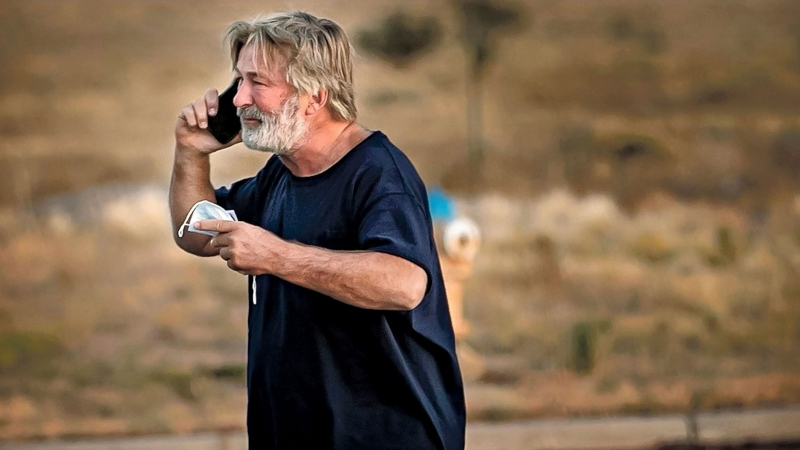 Alec Baldwin speaks on the phone in the parking lot outside the Santa Fe County Sheriff's Office in Santa Fe, N.M., after he was questioned about a shooting on the set of the film 'Rust' on the outskirts of Santa Fe, Thursday, Oct. 21, 2021.  (Jim Weber/Santa Fe New Mexican via AP)