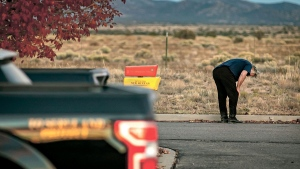 A distraught Alec Baldwin lingers in the parking lot outside the Santa Fe County Sheriff's Office in Santa Fe, N.M., after he was questioned about a shooting on the set of the film 'Rust' on the outskirts of Santa Fe, Thursday, Oct. 21, 2021. (Jim Weber/Santa Fe New Mexican via AP)
