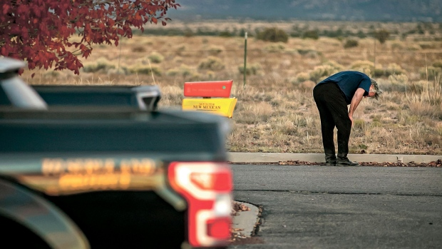 """A distraught Alec Baldwin lingers in the parking lot outside the Santa Fe County Sheriff's Office in Santa Fe, N.M., after he was questioned about a shooting on the set of the film """"Rust"""" on the outskirts of Santa Fe, Thursday, Oct. 21, 2021. (Jim Weber/Santa Fe New Mexican via AP)"""