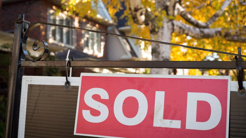 A real estate sold sign hangs in front of a home in this file photo dated Nov. 4, 2016.THE CANADIAN PRESS/Graeme Roy