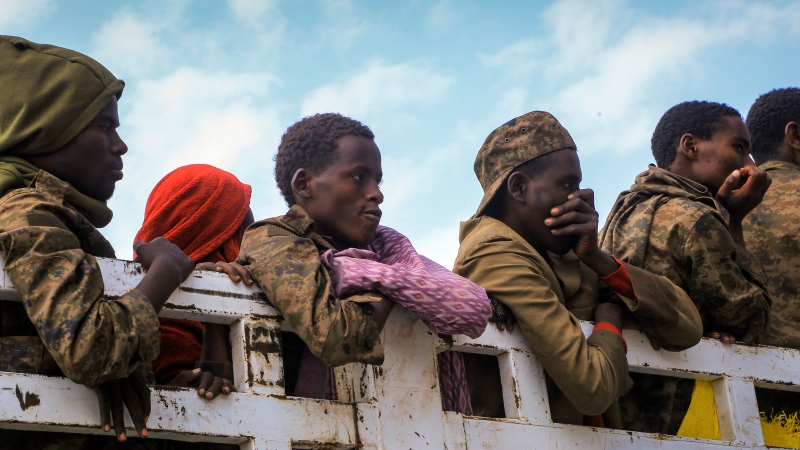 Captured Ethiopian government soldiers and allied militia members are paraded by Tigray forces through the streets in open-top trucks, as they arrived to be taken to a detention center in Mekele, the capital of the Tigray region of northern Ethiopia Friday, Oct. 22, 2021. (AP Photo)