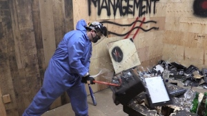Jared Daw does some smashing at Anger Management Destruction Therapy Clinic in Clinton, Ont. in October 2021. (Scott Miller / CTV News)