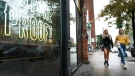 People walk past retail storefronts during the COVID-19 pandemic in Toronto on Wednesday, September 22, 2021. THE CANADIAN PRESS/Nathan Denette
