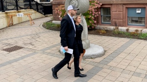 Pastor Philip Hutchings, left, and his wife Jamie Hutchings leave the Courthouse in Saint John, N.B., Friday, Oct. 22, 2021. Hutchings, a New Brunswick pastor, is free after spending a week in jail and apologizing to the courts for alleged breaches of COVID-19 public health rules. THE CANADIAN PRESS/Kevin Bissett