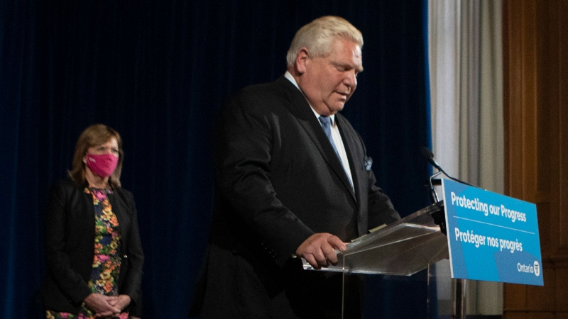 Ontario Premier Doug Ford stands at the podium as he attends a press briefing in Toronto, Friday, Oct. 22, 2021. THE CANADIAN PRESS/Chris Young