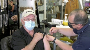 A resident receives a vaccination against COVID-19 in Taber, Alta.
