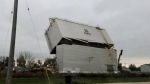 Crews demolish the grain elevator, owned by Artel Farms Ltd., in the Town of Niverville on Oct. 22, 2021. (Source: Niverville Manitoba/ Facebook)