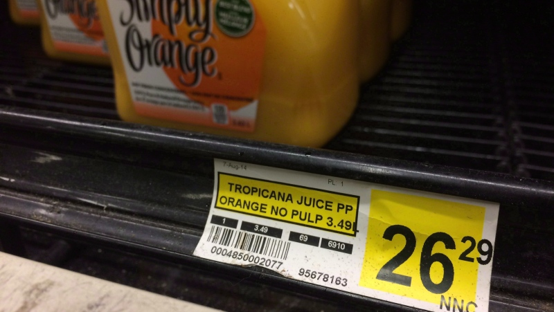 A price tag lists the price of a jug of orange juice at a grocery store in Iqaluit, Nunavut on December 8, 2014. THE CANADIAN PRESS/Sean Kilpatrick