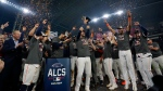 The Houston Astros celebrate their win against the Boston Red Sox n Game 6 of baseball's American League Championship Series Friday, Oct. 22, 2021, in Houston. The Astros won 5-0, to win the ALCS series in game six. (AP Photo/David J. Phillip)