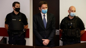 Rémy Daillet-Wiedemann, a former French politician whose popularity grew when he spread QAnon-style conspiracy theories, appears in court in Nancy, France on Wednesday, June 16, 2021, on charges he orchestrated the kidnapping of an 8-year-old girl whose mother had lost custody of her. (AP Photo/Jean-Francois Badias)
