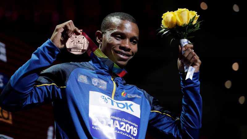 Alex Quinonez of Ecuador, bronze medalist in the men's 200 meters, poses during the medal ceremony at the World Athletics Championships in Doha, Qatar, Wednesday, Oct. 2, 2019. (AP Photo/Nariman El-Mofty)