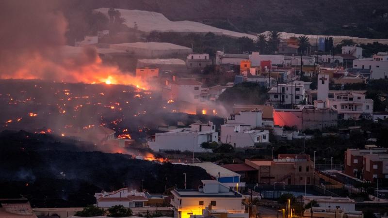 Lava flows from a volcano destroying houses at La Laguna neighbourhood on the Canary island of La Palma, Spain on Thursday Oct. 21, 2021. (AP Photo / Saul Santos)