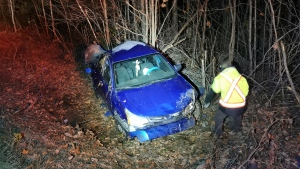 MRC des Collines police say a 35-year-old man from Gatineau, Que. suffered minor injuries in this rollover in Val-des-Monts, Que. early Saturday, Oct. 23, 2021. (Photo submitted by MRC des Collines police)