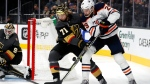 Vegas Golden Knights center William Karlsson (71) and Edmonton Oilers center Leon Draisaitl (29) compete for the puck during the third period of an NHL hockey game Friday, Oct. 22, 2021, in Las Vegas. Golden Knights goaltender Robin Lehner is at left (AP Photo/Steve Marcus).