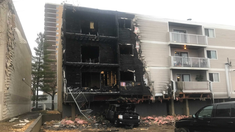 Flames engulfed the four-storey apartment complex building in central Edmonton early Saturday morning (CTV News Edmonton/Galen McDougall).