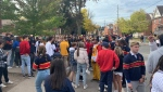 People gather in the University District in Kingston, Ont. Oct. 23, 2021. Kingston police declared aggravated nuisance parties Saturday afternoon. (Kimberley Johnson/CTV News Ottawa)
