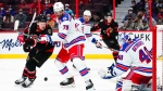 Ottawa Senators left wing Brady Tkachuk (7) battles it out in front of the Rangers' net with New York Rangers defenceman K'Andre Miller (79) during second period NHL action in Ottawa on Saturday, Oct. 23, 2021. (THE CANADIAN PRESS/Sean Kilpatrick)