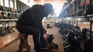 A man tries on ski boots at Mount St. Louis Moonstone in Moonstone, Ont. on Saturday, October 23 (Rob Cooper/CTV News)