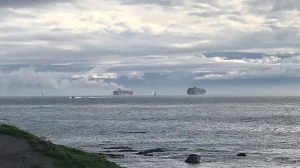 The fire was sparked inside two containers that were damaged when the ship was tossed by rising seas Friday afternoon. (CTV News)