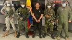 """In this photo released by the Colombian presidential press office, one of the country's most wanted drug traffickers, Dairo Antonio Usuga, alias """"Otoniel,"""" leader of the violent Clan del Golfo cartel, is presented to the media at a military base in Necocli, Colombia, Oct. 23, 2021. (Colombian presidential press office via AP)"""