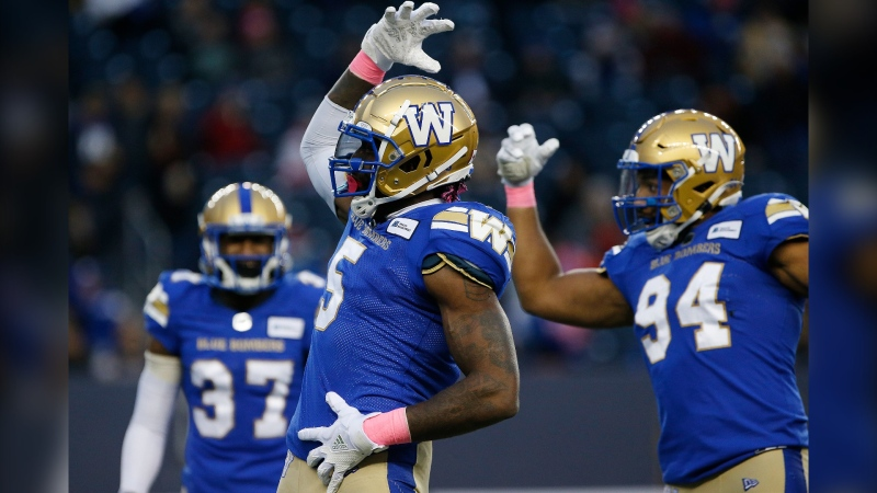Winnipeg Blue Bombers' Willie Jefferson (5) and Jackson Jeffcoat (94) celebrate their sack of B.C. Lions quarterback Mike Reilly (not shown) during the first half of CFL action in Winnipeg Saturday, October 23, 2021. (THE CANADIAN PRESS/John Woods)