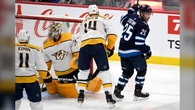 Winnipeg Jets' Paul Stastny (25) celebrates his goal on Nashville Predators goaltender Juuse Saros (74) during the second period of NHL action in Winnipeg on Saturday, October 23, 2021. (THE CANADIAN PRESS/Fred Greenslade)