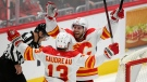 Calgary Flames center Elias Lindholm (28) celebrates with left wing Johnny Gaudreau (13) after scoring the game-winning goal in overtime of an NHL hockey game against the Washington Capitals, Saturday, Oct. 23, 2021, in Washington. (AP Photo/Nick Wass)