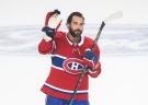 Montreal Canadiens' Mathieu Perreault salutes the crowd following an NHL hockey game against the Detroit Red Wings in Montreal, Saturday, October 23, 2021. Perreault scored three goals in the game. THE CANADIAN PRESS/Graham Hughes