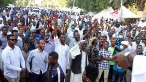 Sudanese protesters take part in the second day of a sit-in to call for the dissolving of the joint military-civilian government, outside the presidential palace in Khartoum, Sudan, Sunday, Oct. 17, 2021. (AP Photo/Marwan Ali)