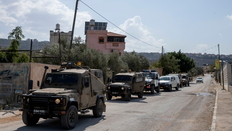 Israeli army and police investigators inspect damaged Palestinian properties after Israeli settlers vandalized residents overnight, in the West Bank village of Marda, north of Salfit, Wednesday, Oct. 13, 2021. (AP Photo/Nasser Nasser)