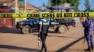 Police secure a road leading to the scene of an explosion in the Komamboga suburb of the capital Kampala, Uganda Sunday, Oct. 24, 2021. (AP Photo/Nicholas Bamulanzeki)
